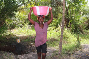 The Water Project: Kamasondo, Robay Village, Next to Mosque -  Woman Carrying Water