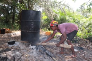 The Water Project: Kamasondo, Robay Village, Next to Mosque -  Woman Processing Palm Oil