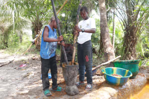 The Water Project: Kamasondo, Robay Village, Next to Mosque -  Young Boys Processing Palm Oil
