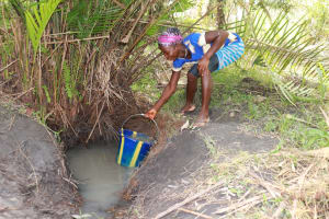 The Water Project: Kamasondo, Robay Village, Next to Mosque -  Young Girl Collecting Water