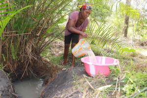 The Water Project: Kamasondo, Robay Village, Next to Mosque -  Woman Collecting Water