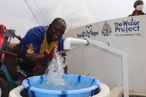 The Water Project: Lungi, Rotifunk, 22 Kasongha Road -  Chairman Splashes Clean Water