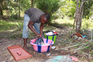 The Water Project: Kamasondo, Robay Village, Next to Mosque -  Young Boy Laundering