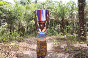 The Water Project: Kamasondo, Robay Village, Next to Mosque -  Young Girl Carrying Water