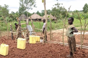 The Water Project: Alero B Community -  Children Fetch Water At The Well