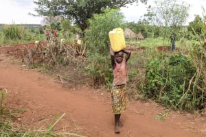 The Water Project: Alero B Community -  Grace A Carrying Water