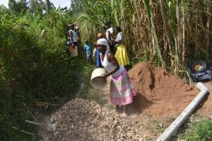 The Water Project: Bukhakunga Community, Maikuva Spring -  Community Members Deliver Construction Materials By Hand