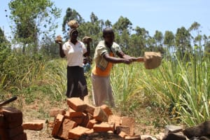 The Water Project: Litinye Community, Vuyanzi Spring -  Delivering Materials To The Spring Site