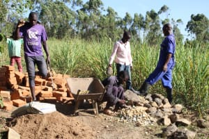 The Water Project: Litinye Community, Vuyanzi Spring -  Making Gravel And Delivering Materials