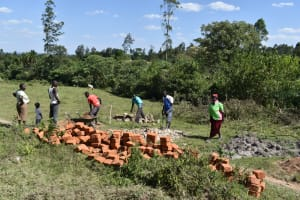 The Water Project: Makale Community, Kwalukhayiro Spring -  Community Members Help Deliver And Prepare Materials