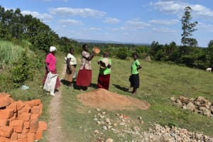 The Water Project: Makale Community, Kwalukhayiro Spring -  Women Deliver Materials To The Spring