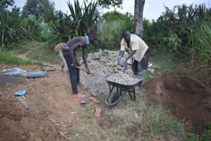 The Water Project: Wepika Community, Musa Mmasi Shikwe Spring -  Community Members Help Mobilize Construction Materials