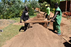 The Water Project: Saosi Primary School -  Community Members Help Sift Sand