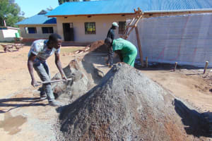 The Water Project: Saosi Primary School -  Community Members Prepare Cement And Concrete Materials