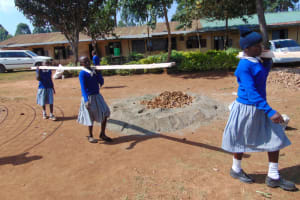 The Water Project: Saosi Primary School -  Pupils Help Deliver Materials