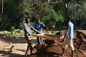 The Water Project: Shikomoli Primary School -  Community Members Help Sift Sand
