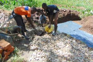 The Water Project: Shamoni Community, Shatuma Spring -  Mixing Of Concrete