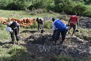 The Water Project: Makale Community, Kwalukhayiro Spring -  Community Members Help Mix Concrete