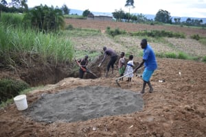 The Water Project: Wepika Community, Musa Mmasi Shikwe Spring -  Community Members Help Excavate And Prepare Cement