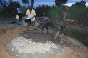 The Water Project: Wepika Community, Musa Mmasi Shikwe Spring -  Community Members Mix Concrete