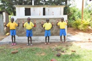 The Water Project: Shikomoli Primary School -  Boys Posing At New Latrines