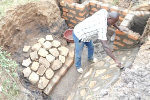 The Water Project: Khaunga A Community, Murutu Spring -  Plastering The Stone Pitching