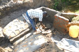 The Water Project: Mwitwa Community, Matiang'i Spring -  Plastering