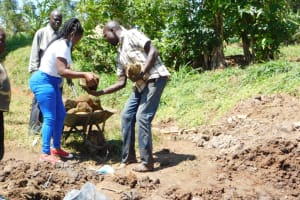 The Water Project: Khaunga A Community, Murutu Spring -  Passing Large Rocks For Backfilling