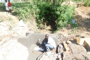 The Water Project: Mwitwa Community, Matiang'i Spring -  Fitting The Tiles