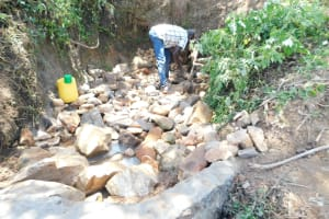 The Water Project: Mwitwa Community, Matiang'i Spring -  Layer Of Large Rocks
