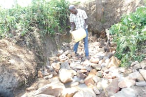 The Water Project: Mwitwa Community, Matiang'i Spring -  Layer Of Small Rocks