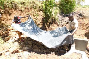 The Water Project: Khaunga A Community, Murutu Spring -  Laying The Tarp