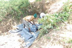 The Water Project: Mwitwa Community, Matiang'i Spring -  Fitting The Tarp
