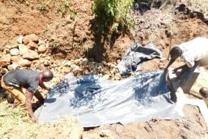 The Water Project: Khaunga A Community, Murutu Spring -  Fitting The Sheet