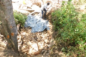 The Water Project: Mwitwa Community, Matiang'i Spring -  Backfilling With Soil