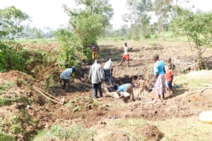 The Water Project: Khaunga A Community, Murutu Spring -  Backfilling With Soil