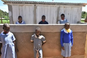 The Water Project: Saosi Primary School -  Girls Pose At Their New Toilets