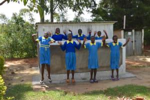 The Water Project: Shikomoli Primary School -  Girls Celebrating At New Latrines