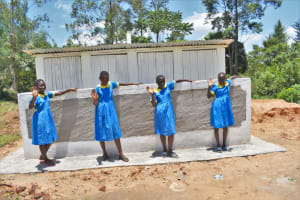 The Water Project: Isikhi Primary School -  Girls Posing At Their New Latrines