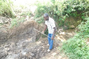 The Water Project: Mwitwa Community, Matiang'i Spring -  Measuring Excavated Area