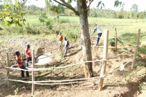 The Water Project: Mwitwa Community, Matiang'i Spring -  Setting Up Fence