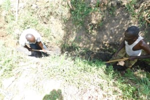 The Water Project: Khaunga A Community, Murutu Spring -  Digging A Drainage Channel