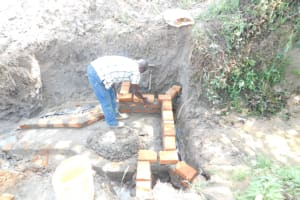The Water Project: Mwitwa Community, Matiang'i Spring -  Raising The Walls