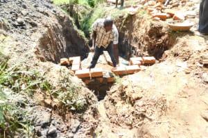The Water Project: Khaunga A Community, Murutu Spring -  Raising The Walls