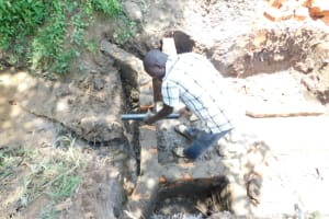 The Water Project: Mwitwa Community, Matiang'i Spring -  Setting The Pipe
