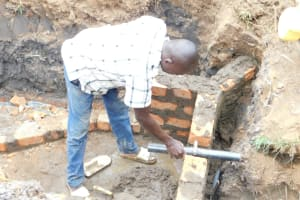 The Water Project: Khaunga A Community, Murutu Spring -  Setting The Pipe