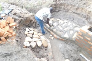 The Water Project: Mwitwa Community, Matiang'i Spring -  Plastering The Stone Pitching