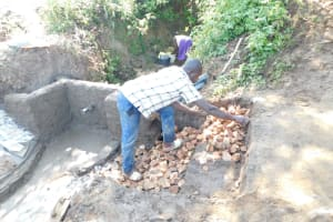 The Water Project: Mwitwa Community, Matiang'i Spring -  Setting Up The Staircase