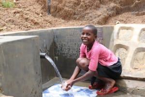 The Water Project: Wepika Community, Musa Mmasi Shikwe Spring -  Enjoying Clean Flowing Water