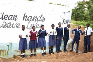 The Water Project: Kimuuni Secondary School -  Students Drink Water From The Tank